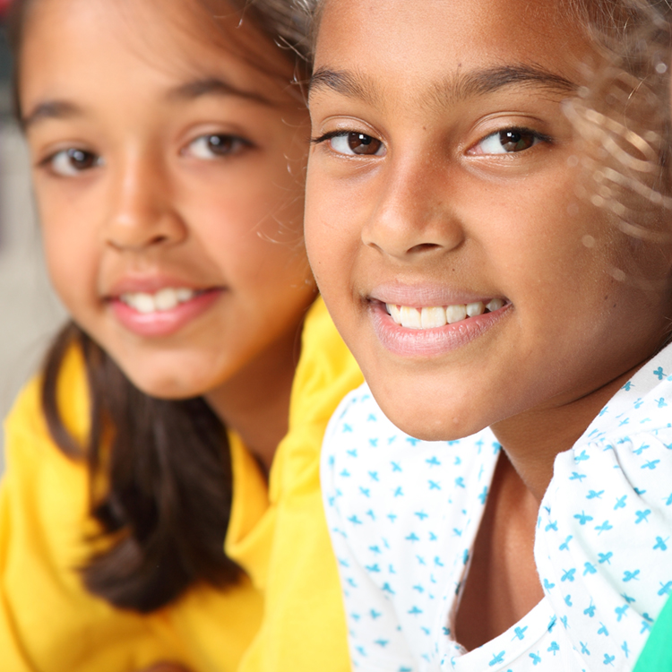 Two local elementary aged girls smiling